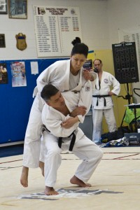 Karl and Diane demonstrating Ippon Seoinage at the DeMatha clinic