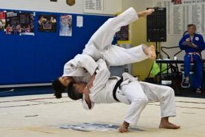 Karl Tamai and Diane Tamai Jackson demonstrate Ura Nage at the DeMatha clinic