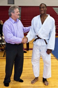 Outstanding Senior Competitor Chima Uwazi is congratulated by Tournament Director Barry Snader
