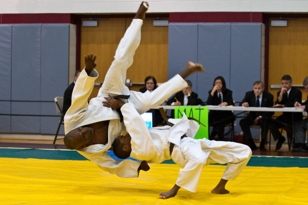 John Waite takes flight at the hands of his son, Connor, demonstrating Ura Nage during the Nage-No-Kata competition