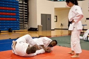 "Hurd and Young demonstrating ""Ashi Garami"" under the watchful eye of Sensei Jackson"