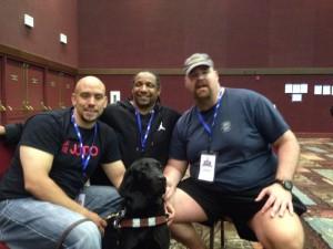 Jason LeFever, Harvey Guary, Chip Jost, and Jason's service dog Coach