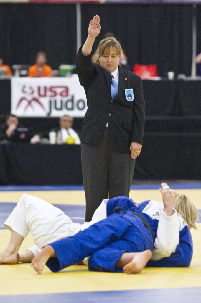 Landstreet refereeing Olympic Champion Kayla Harrison's match