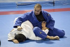 Steve Matias preparing to rip Edwin Vallejo's arm off