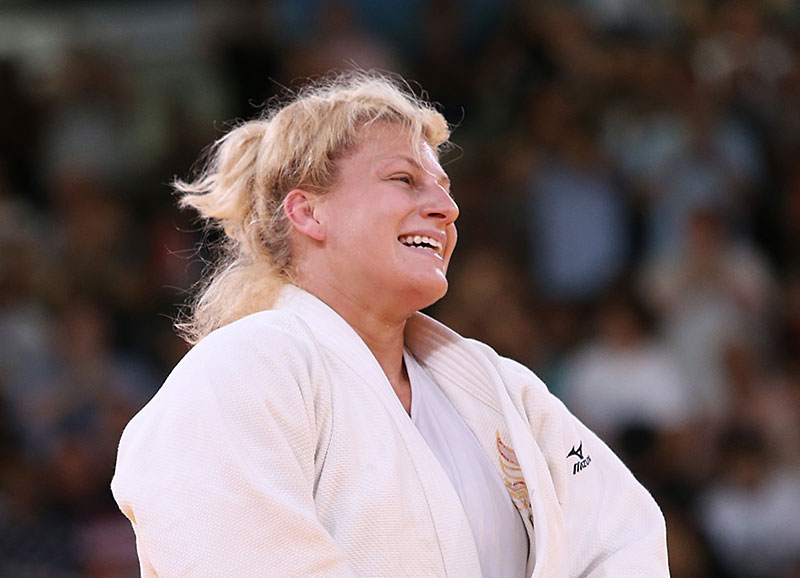 HARRISON WINS FIRST OLYMPIC GOLD